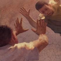 Un padre intenta agarrar a su hijo